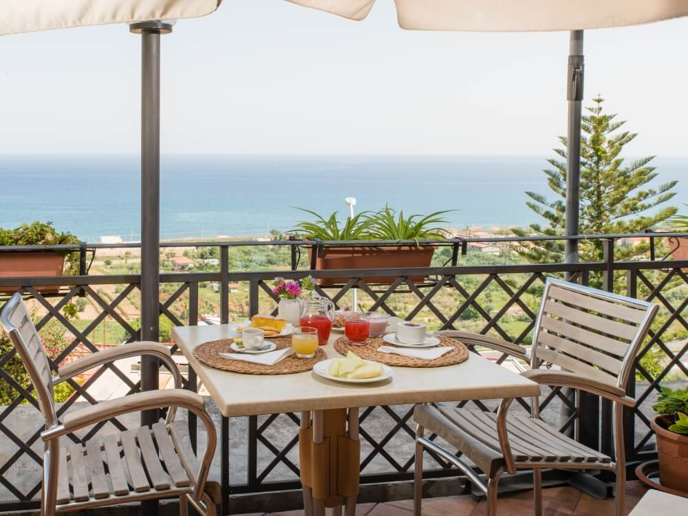 Terrace with the background of the intense Sicilian sea
